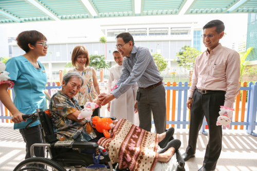 SMRT CEO engaging elderly from St Joseph's Home