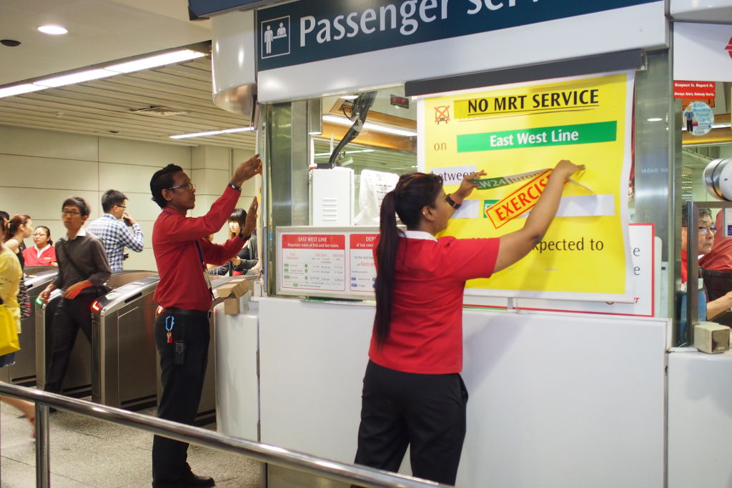 SMRT Assistant Station Managers setting up exercise signs at Tiong Bahru