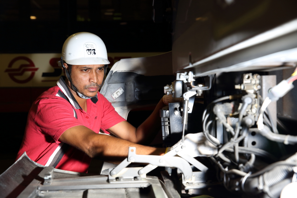 SMRT Lead Technician checks on bus