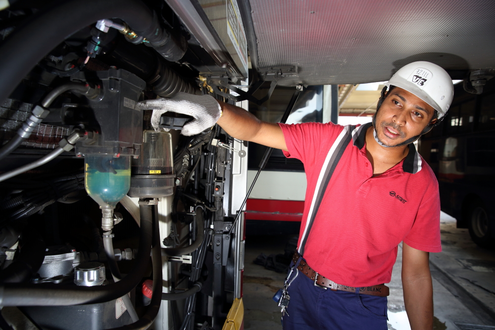 SMRT Lead Technician checks the MAN A22 engine