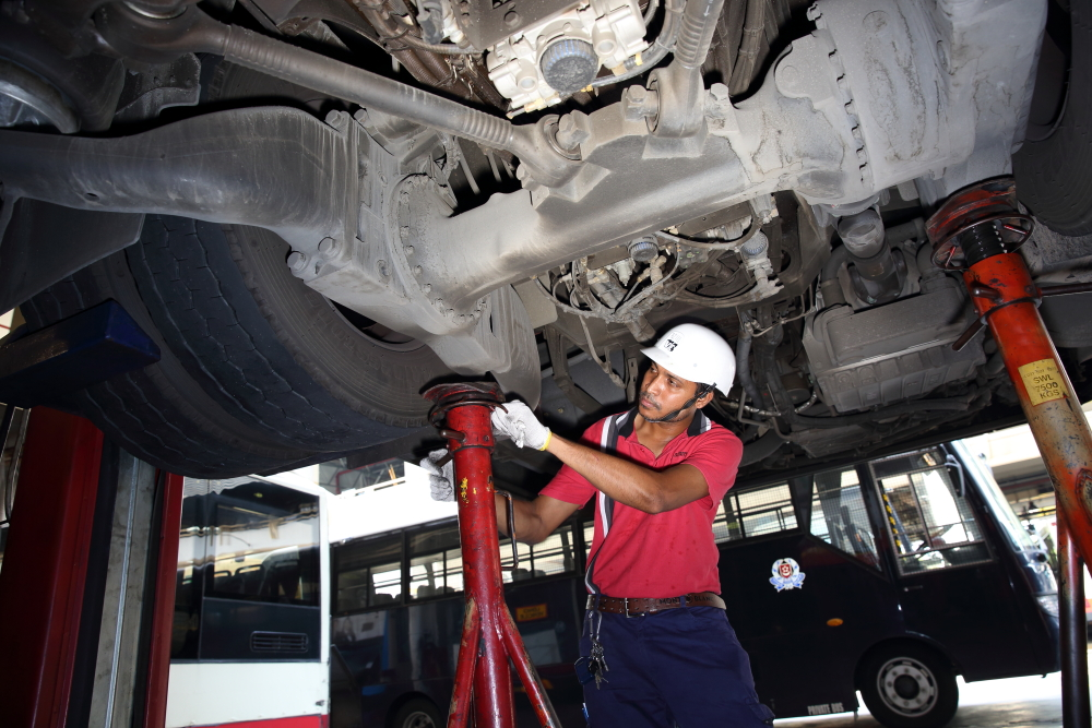 SMRT Lead Technician props the bus up