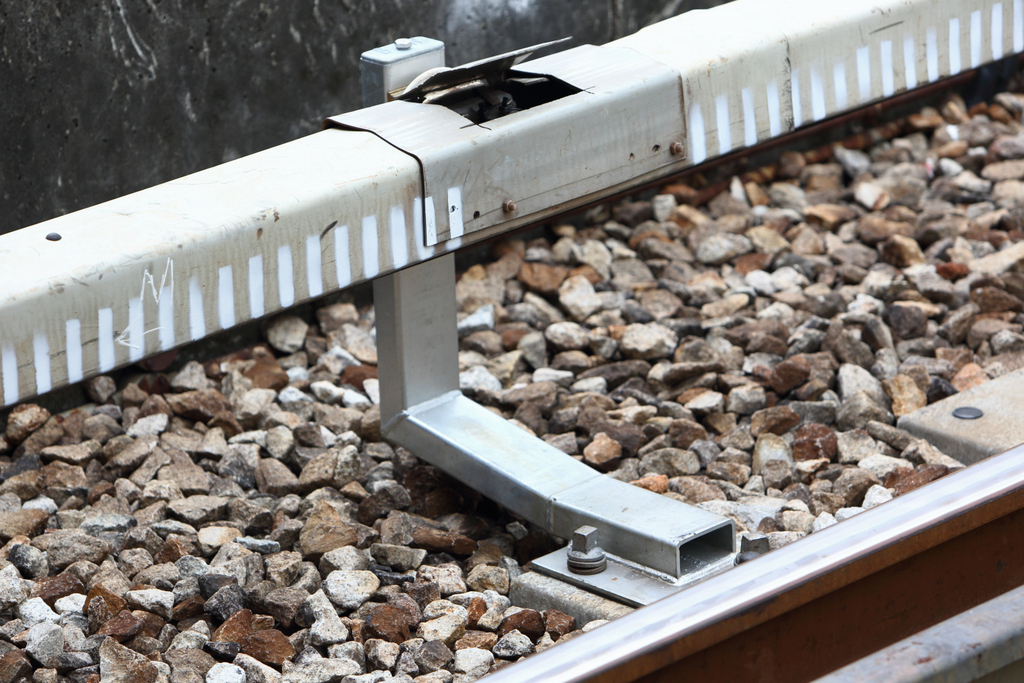 The Third Rail Assembly holds the third rail in place so that the Current Collector Device on the trains can draw power from it.